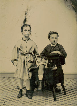 [Studio portrait of girl and boy]