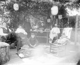 [Stark family and cook assembled on porch of summer cottage at English Bay]
