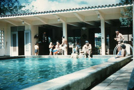 Ozama Club [People lounging by the pool]