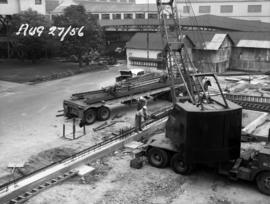 Raw sugar warehouse: construction of new handling and weighing in old