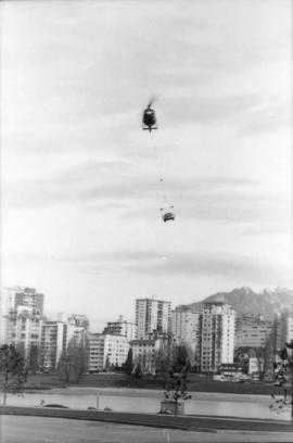 Helicopter delivering car to Vanier Park parking lot
