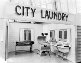 Display depicting a city laundry room