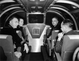"[Men sitting in the stainless steel ""dome"" during the launch of ""The Canadian""]"
