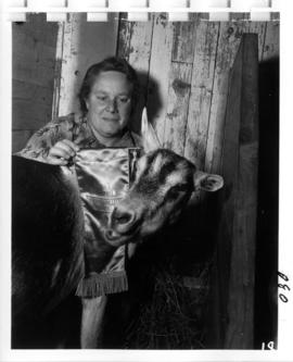 Woman with award-winning goat in 1956 P.N.E. Livestock competition