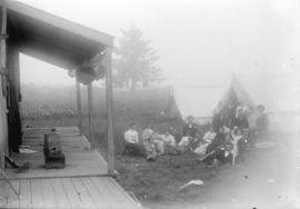 [Group assembled outside tents at Linn's Cottage at Lynn Creek]