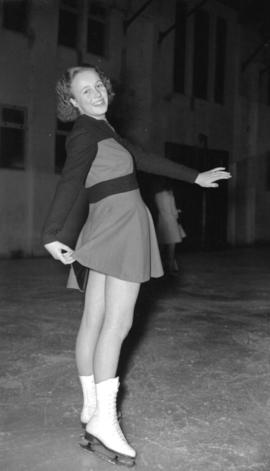 [Woman in figure skating pose, possibly at the Rotary Ice Carnival]