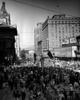 1947 P.N.E. Opening Day Parade crowd along Georgia St.