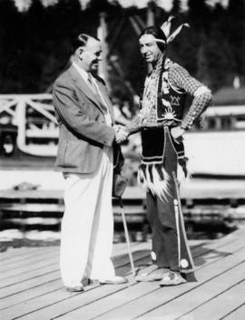 Mayor G.G. McGeer and Scout Grey Eagle at Indian aquatic sports, Coal Harbour