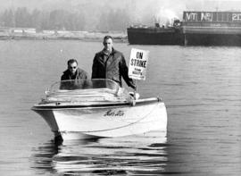 Tow boat operators Hugh Gwynn and Jim Hutton picketing from power boat