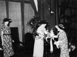 Lady Tweedsmuir presented with bouquet by Mrs. F.J. Rolston at Woman's Club tea