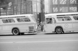 Two buses outside the Eaton's Building