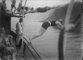 Swimmers diving off a boat