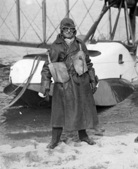 [Mayor L.D. Taylor standing in front of seaplane at Jericho Beach Station before flight]