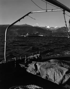 [View of the North Shore and the Lions taken from a boat showing North Vancouver Ferry No. 5 cros...