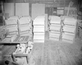 [Empty Bantam Books display racks at a carpentry shop]