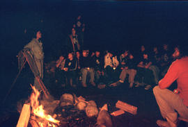 Group around camp fire at Camp Capilano