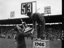 "P.N.E. General Manager A.P. ""Bert"" Morrow presenting trophy to 1966 Inter High Track fi..."