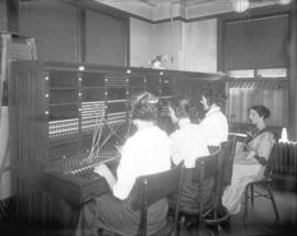 "[Women working at switchboard of B.C. Electric PBX Exchange (""Seymour 5000""), located o..."