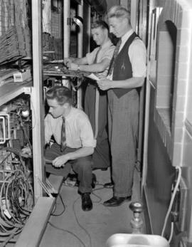 [B.C. Telephone technicians at work on telephone equipment]