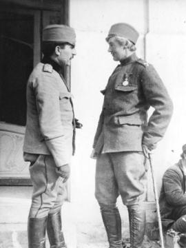 [Sergeant Major Flora Sandes recovering from injury is congratulated by a Serbian Officer]