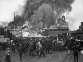 [Crowd watching fire at Canadian Fishing Company dock]