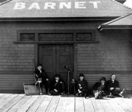 [James Crookall and other photographers at the Barnet Station]