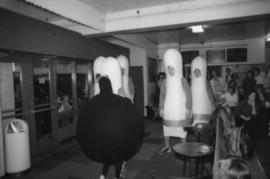 Group dressed as bowling pins and a bowling ball