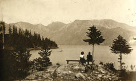 Couple seated on bench overlooking Snug Cove, Bowen Island, B.C.