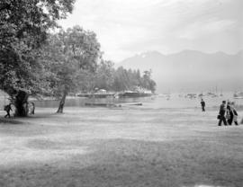 [View of Bowen Island harbour showing boats moored in the bay and a Union Steamships vessel in th...