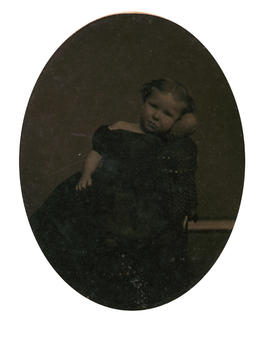 [Studio portrait of young girl, reclining]