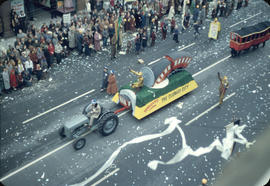 43rd Grey Cup Parade, on Granville Street, Toronto Subway float with tractor, streetcar costume a...