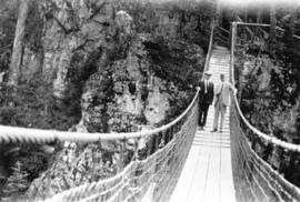[L.D. Taylor and unidentified man on the Capilano Suspension Bridge]