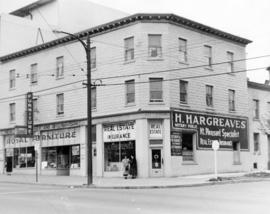 [Exterior of building at corner of Main Street and East 10th Avenue]