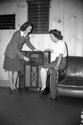 [2 women listening to the radio at the Burrard Servicemen's Centre, 636 Burrard Street]