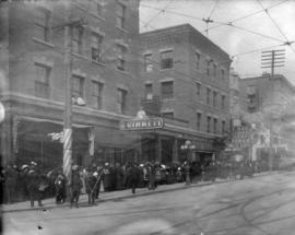 [Crowds lined up in the 700 block Granville Street for entrance into the Vancouver Opera House]
