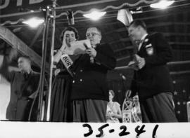 Nancy Hansen on Outdoor Theatre stage with P.N.E. directors after being named Miss P.N.E. 1954