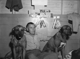 Man with P.N.E. all breed dog show prize winners [Rhodesian ridgebacks]
