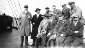 [Group portrait of Mayor L.D. Taylor and several unidentified men on board a ship]