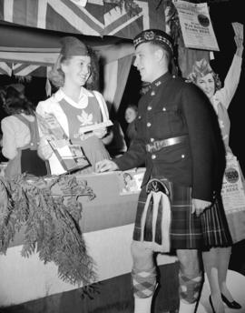 Cadet Butch Bee and Miss Canada [at war savings stamp booth]
