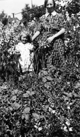 Mrs. Margaret Campbell and daughter, Margaret in garden of house at 3961 West 21st Avenue