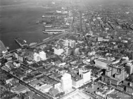 [Aerial view of piers on waterfront looking north east from downtown Vancouver]