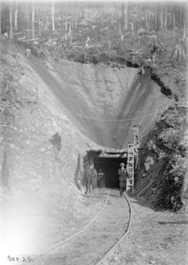 [Men and horse at entrance to tunnel for Buntzen Lake Power Plant number one]