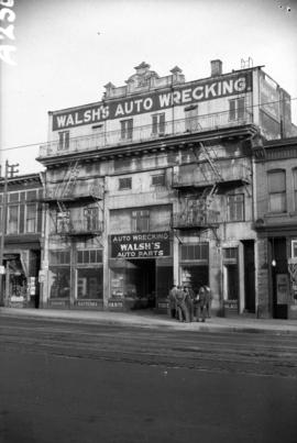 [Exterior view of Walsh's Auto Wrecking on Main Street showing facade of former Imperial The...