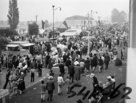 View of crowd and tents along Walter Leek boulevard, with Garden building in background