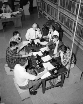 [Group of men talking on telephones possibly as part of the testing of the new system]