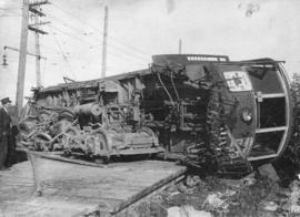 H. Cottrell [standing beside an overturned B.C.E.R. interurban streetcar] at the foot of Main Str...