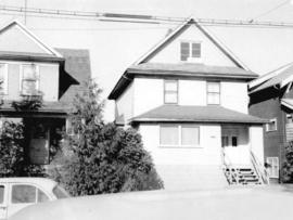 "[View of ""old"" (ca 1909?) one-and-one-half storey house at 1437 East 10th Avenue]"