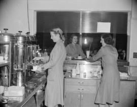 [Women from the Junior League serving beverages from a refreshment booth]