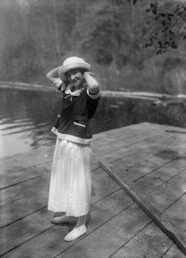 Woman posing on a dock