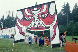 Large banner with face design at the Centennial Commission's Canada Day celebration